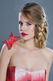 Woman beauty portrait with butterfly on her shoulder Royalty Free Stock Photo