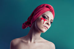 Woman beauty portrait with red towel. And red color on her face Royalty Free Stock Photos