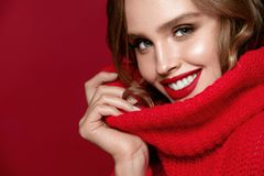 Woman Beauty Portrait. Sexy Female Model With Red Lips. Beautiful Young Happy Woman With Bright Professional Makeup And Red Lipstick On Red Background. High Stock Images