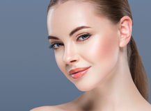 Woman beauty portrait skin care concept on blue background. Stock Image
