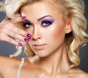 Woman with beauty purple makeup of eyes. Stock Image