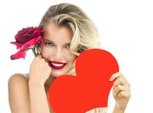 Woman beauty red heart valentine`s love. Beauty portrait of attractive caucasian smiling woman blond on white studio shot red rose lips toothy smile face long stock photos