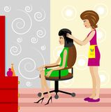 Woman in a beauty salon does a hair-do Stock Image