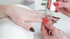 Woman in a Beauty Salon receiving a manicure stock video