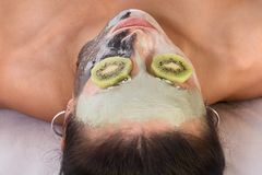 Woman in beauty spa  experimental facial treatment Stock Photo