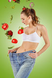 Woman became skinny and wearing old jeans. On white background. concept of healthy lifestyle and beauty stock photo
