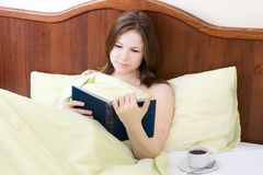 Woman in the bed Stock Images
