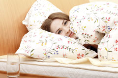 Woman in a bed Stock Image