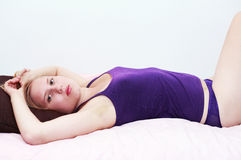 Woman on bed Stock Image