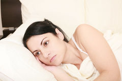 Woman in the bed. Worried woman in the bed Royalty Free Stock Photography