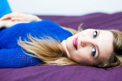 Woman on the bed Stock Photo