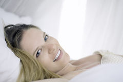 Woman lying in canopy bed Royalty Free Stock Photo