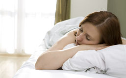 Woman in bed Stock Photography