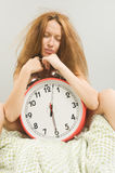 Woman in bed with alarm clock Royalty Free Stock Images