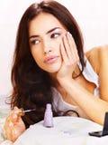Woman in bed applying nail polish Royalty Free Stock Photography