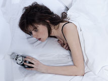 Woman in bed awakening Stock Image