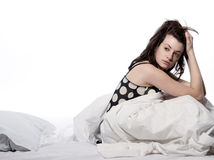 Woman in bed awakening tired insomnia hangover Stock Images