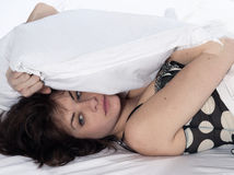 Woman in bed awakening. Young funky cool caucasian man portrait in studio on white background Stock Photo