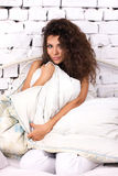 Woman  in the bed Stock Photos