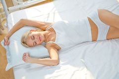 Woman on the bed at bedroom Stock Photography