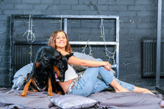 Woman in bed with big dog Royalty Free Stock Photo