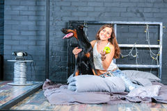 Woman in bed with big dog Royalty Free Stock Photos