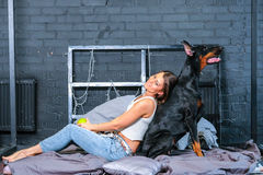 Woman in bed with big dog Stock Photo
