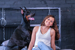 Woman in bed with big dog Royalty Free Stock Images
