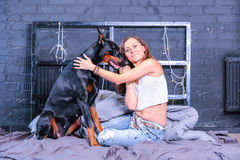Woman in bed with big dog Stock Images
