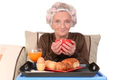 Woman in bed, breakfast Stock Photo