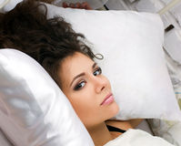 Woman in the bed Stock Image