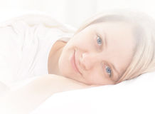 Woman on bed royalty free stock photos