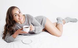 Woman in bed with coffee Stock Photography