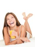 Woman in bed drinking Juice stock photos