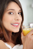 Woman in bed drinking orange juice Royalty Free Stock Photo