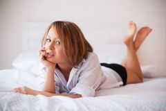 Woman in bed in the early morning Royalty Free Stock Image