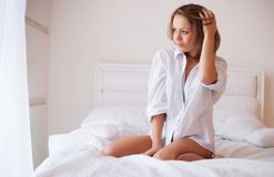 Woman in bed in the early morning Stock Photos