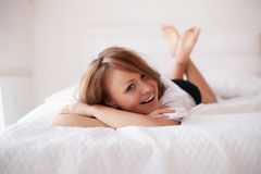 Woman in bed in the early morning Stock Photography