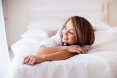 Woman in bed in the early morning Royalty Free Stock Photo
