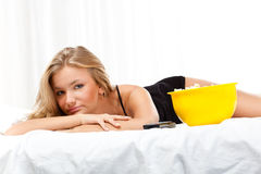 Woman on bed eating popcorn Stock Photography