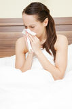 Woman in the bed with flu Royalty Free Stock Photos