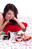 Woman in bed with gifts Stock Photography