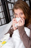 Woman in bed with a handkerchief Stock Images