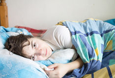 Woman in bed with a handkerchief Royalty Free Stock Images
