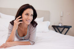 Woman on the bed having a phone call Royalty Free Stock Images