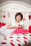 Woman in bed with hearts Royalty Free Stock Image