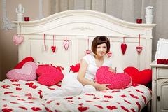 Woman in bed with hearts Royalty Free Stock Photo