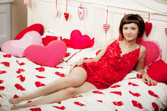 Woman in bed with hearts Stock Images