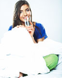 Woman in bed holding water glass. Royalty Free Stock Photos