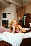 Woman in bed at home Royalty Free Stock Photo